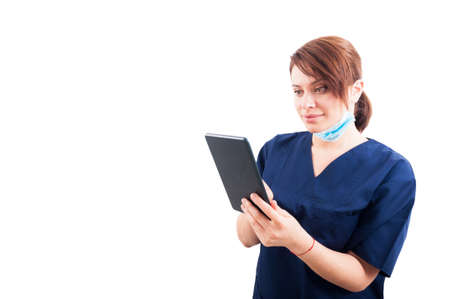 assistant: Attractive woman doctor using wireless tablet on white copyspace