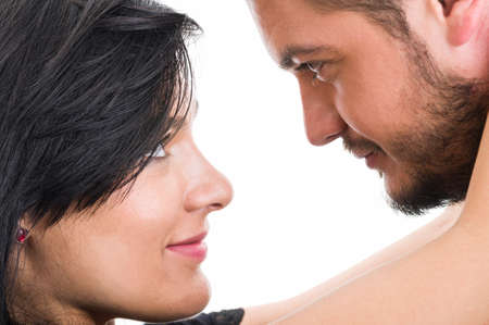 two woman: Couple looking into each others eyes on white background