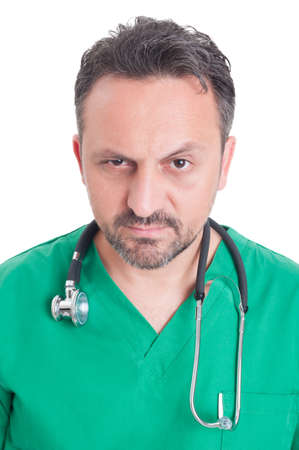 lifted: Face portrait of a young serious doctor with lifted eyebrow