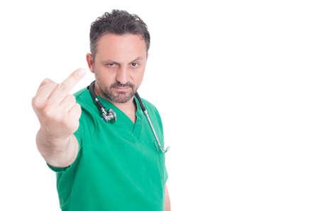 obscene: Male doctor showing obscene middle finger gesture on white background