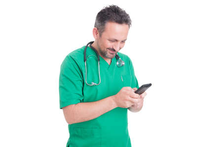 pager: Modern doctor texting sms and reading on smartphone while smiling on white background