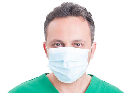 surgeon mask: Headshot or portrait of a man doctor wearing surgeon mask isolated on white background