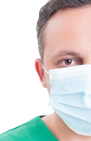 surgical mask: Half face of a handsome male doctor with surgical mask Stock Photo