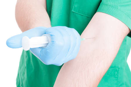 inoculation: Doctor injecting himself in the arm with vaccine from a syringe