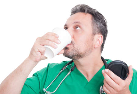 relishing: Young doctor drinking coffee and having a break Stock Photo