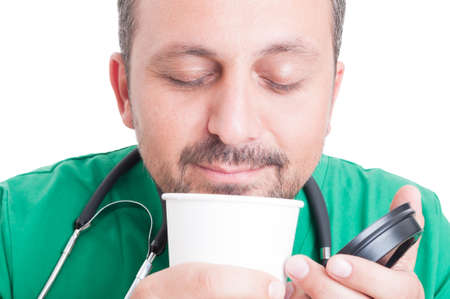 relishing: Doctor enjoying the smell or fresh coffee on white background