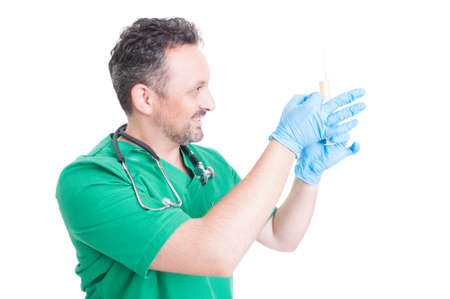 Doctor preparing a syringe with vaccine by tapping it to remove the air bubbles