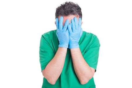 Medical malpractice concept with doctor or surgeon covering his face after surgical mistake Stockfoto