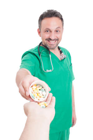 dosage: Smiling, young and confindent doctor giving pills to patient from plastic cup as recommended dosage Stock Photo