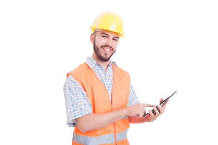 Friendly and modern construction worker or builder using tablet