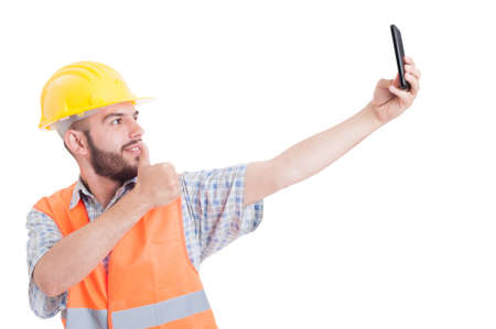 are taking: Engineer or architect taking a selfie showing like gesture