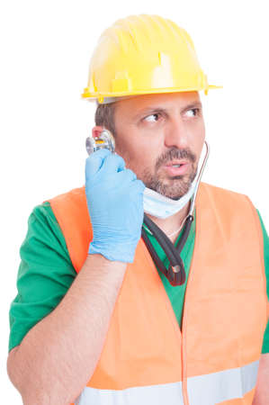 decission: Chose the right career concept with man wearing doctor and builder clothes listening the stethoscope