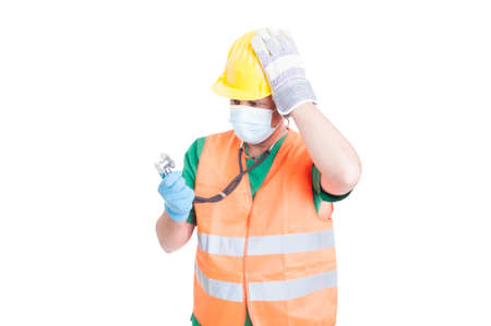 decission: Confused doctor or medic wearing builder clothes as vest and helmet Stock Photo