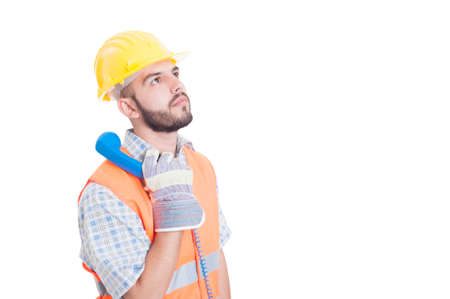 waiting phone call: Construction worker or builder holding phone and waiting for a call