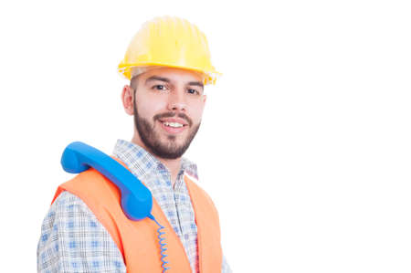 waiting phone call: Contact person for construction company waiting a call with phone on shoulder