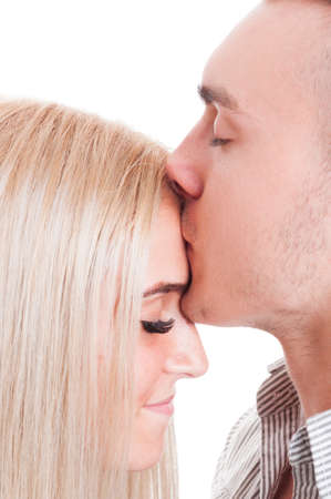 with true love: Man kissing woman forehead. Close-up with true love concept on white background