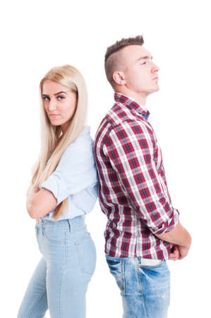 lovers quarrel: Young couple after quarrel, dispute or fight standing back to back upset, angry, frustrated and stubborn Stock Photo