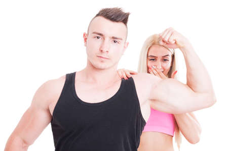 impressed: Impressed woman by personal trainer muscles. Bodybuilder boyfriend with sexy fitness girlfriend