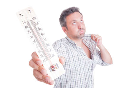 Sweaty man holding thermometer as summer heat concept isolated on white