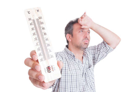 Sumer heat and heatwave concept with man holding thermometer isolated on white Archivio Fotografico
