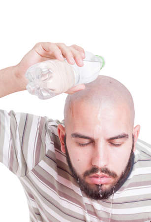 summer heat: Man cooling by pouring water over head in summer heat. Hydration or dehydration on heatwave  concept