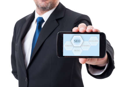 optimize: Man holding smartphone with SEO or search engine optimization diagram Stock Photo