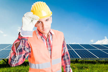 solarenergy: Confident and polite engineer or technician on solar power photovoltaic panels background