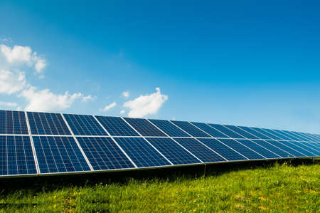 Green energy with solar panels outdoor as alternative power in renewable resource Stockfoto