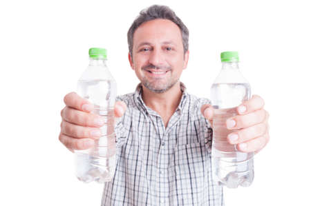 summer heat: Man giving or offering two bottles of cold water. Stay hydrated during summer heat concept Stock Photo
