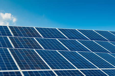 solarpower: Solar panels on blue sky with copy space and text area Stock Photo