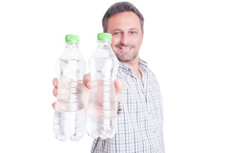 dehydration: Man offering bottles of cold water as summer dehydration and hydration concept isolated on white