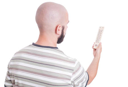 old mercury: Man looking at thermometer isolated on white
