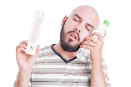 summer heat: Summer heat and dehydration concept with man holding thermometer and cold water bottle
