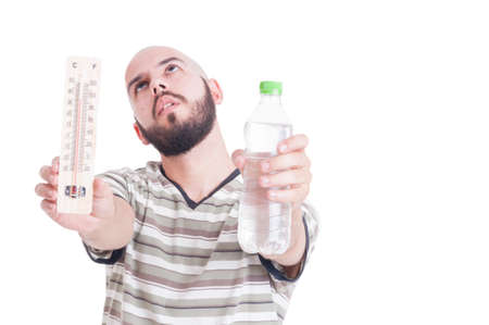 heat wave: Heat wave in summer season concept with man holding thermometer and cold water bottle Stock Photo