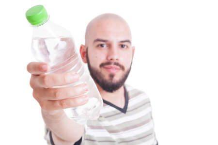 heat wave: Man offering a plastic bottle of cold water for hydration during summer heat wave