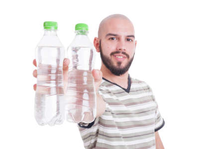 summer heat: Happy man holding two bottles of cold water as hydration in summer heat concept