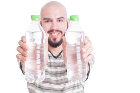 dehydration: Happy man holding two plastic bottles of water as hydration or dehydration in summer heat concept