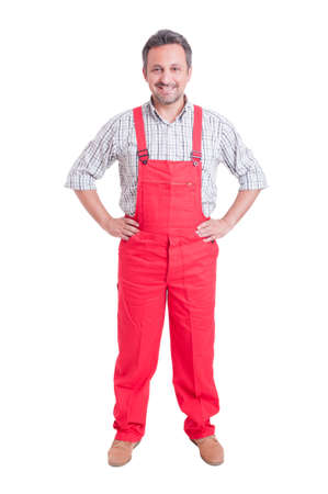 plumber: Proud mechanic, electrician or plumber standing isolated on white Stock Photo