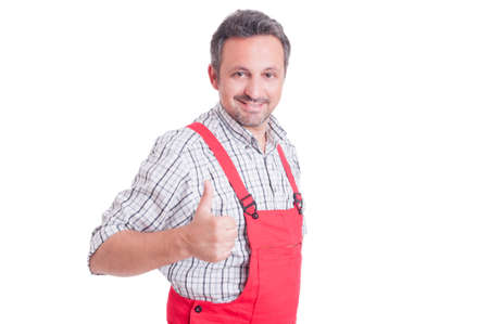 thumbup: Mechanic or electrician showing like or thumb-up gesture smiling confident and successful isolated on white