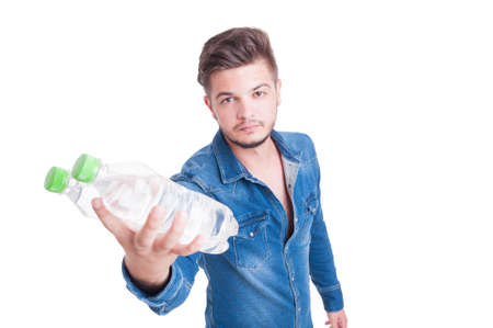 dehydration: Young handsome man handing two bottles of cold water in summer heat season as dehydration concept Stock Photo