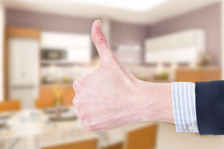 thumbup: Like or thumb-up  gesture on house indoor background as real estate agency offer concept