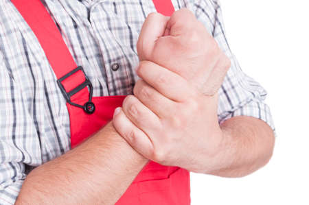 wrist pain: Wrist pain concept as medical problem for mechanic or plumber Stock Photo
