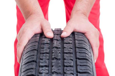 vulcanization: Tire vulcanization services concept with mechanic pushing car wheel