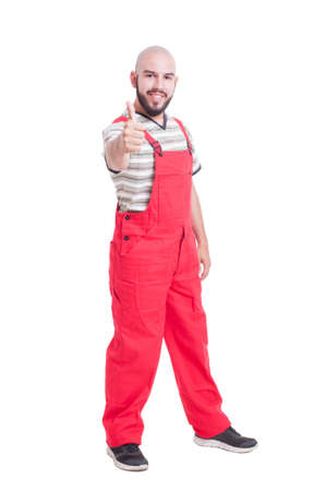thumbup: Plumber or mechanic showing like and thumb-up gesture smiling isolated on white