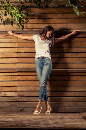 de vaqueros: concepto de moda y religiosa con el modelo femenino que lleva la camiseta y los pantalones vaqueros Foto de archivo