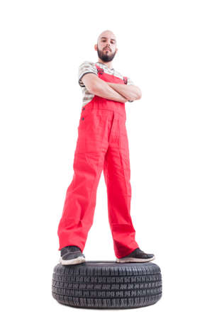 qualified worker: Hero shot low angle of proud and confident mechanic isolated on white Stock Photo