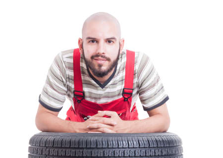leans on hand: Friendly mechanic face as auto garage representative