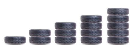 tire tread: Piles of car tires as growing chart isolated on white