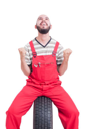 the victorious: Excited and cheerful mechanic making winner and victorious gesture isolated on white Stock Photo