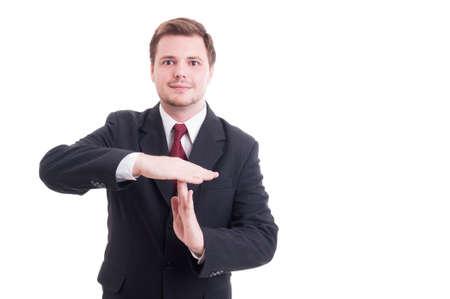 Director empresarial o de negocios que muestra gesto de tiempo de espera sonriente aislados en blanco Foto de archivo